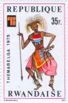 "Dancer with spear and seed pod ankle rattles, ""Themabelga"" Stamp Exhibition in Brussels. Local costumes."