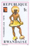 "Witch-doctor dancing covered with body paint, ""Themabelga"" Stamp Exhibition, Brussels. African costumes"